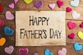Fathers day composition textile hearts on the floor studio shot on wooden background Stock Photo