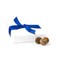 Fathers day gift high key simple white tied with a blue ribbon with chocolate truffles against a white background copy space Stock Image