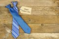 Fathers Day gift tag with ties on rustic wood Royalty Free Stock Photo