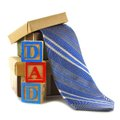 Fathers day gifts dad toy blocks with gift boxes and ties over white Royalty Free Stock Photography
