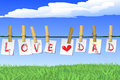Fathers day the love dad letters on the meadow background Royalty Free Stock Photos