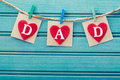 Fathers day message on felt hearts over blue wooden board Royalty Free Stock Image
