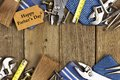 Fathers day tag with tools and ties frame on wood happy gift double border of a rustic background Stock Images