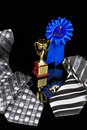 Fathersday Tie, blue ribbon, and trophy cup Royalty Free Stock Photography