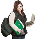 Fatigued student with computer and school supplies Royalty Free Stock Photos
