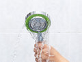Faulty shower head with uneven streams of water Royalty Free Stock Images
