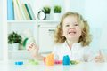 Favorite hobby excited child enjoying her playing with modeling clay Stock Photography