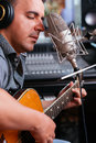 Favorite song man playing guitar and singing his Royalty Free Stock Photography