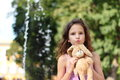 Favorite toy portrait of a girl with a on the background of nature soft focus bokeh Stock Photos