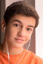 Favourite music cheerful teenage boy in headphones listening to the and looking at camera Stock Photos