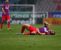 Fc steaua bucharest fc dinamo bucharest cristian tanase reacts after an injury during the football match counting for the romanian Royalty Free Stock Images