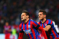 Fc steaua bucharest u cluj adrian popa and alexandru chipciu cheering after scoring a goal during the football match counting for Royalty Free Stock Photos