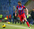 Fc steaua bucharest u cluj alexandru chipciufollowing the ball during the football match counting for the romanian league one Royalty Free Stock Photography