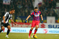 Fc steaua bucharest u cluj claudiu keseru following the ball during the football match counting for the romanian league one Royalty Free Stock Photo