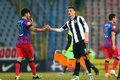 Fc steaua bucharest u cluj cristian tanase shaking hands with an player at the end of the football match counting for the romanian Royalty Free Stock Image