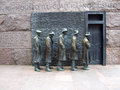 Fdr memorial the breadline statues of unemployed men standing in a bread line during great depression at in washington d c Stock Photo