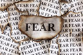 Fear burnt burnt pieces of paper with the word close up Royalty Free Stock Photography