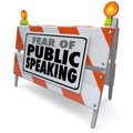 Fear of public speaking words barricade barrier speech event on a road construction or illustrating anxiety or stress over Stock Photos