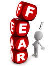 Fear words built word blocks red color top letter f falling over little d man who alarmed afraid white background Stock Photos