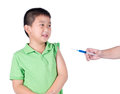 A fearful boy wearing green t shirt be afraid syringe isolated Stock Images
