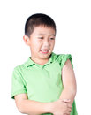 A fearful boy wearing green t shirt look at his left side isolated Royalty Free Stock Image