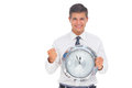 Fearful businessman holding and looking at clock on white background Stock Images