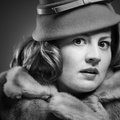 Fearful retro woman a in a faux fur coat looking frightened Royalty Free Stock Photos