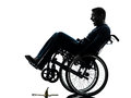 Fearless handicapped man in wheelchair silhouette one studio on white background Royalty Free Stock Photo