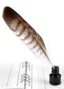 Feather with ink bottle and workbook Royalty Free Stock Photography
