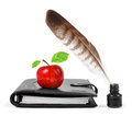 Feather in ink bottle and workbook with an Apple Stock Photography