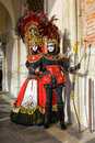 Feather masked women in venice Royalty Free Stock Photo
