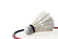 Feather shuttlecock with badminton racket on white Stock Image