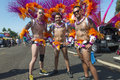 Feathers and sequins three men with in front of a float during the san diego gay pride parade Royalty Free Stock Images