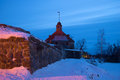 The February evening at the ancient tower of Lars Torstenson. Fortress Korela, Russia Royalty Free Stock Photo
