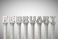 February month sign on a classic columns greek style Stock Images