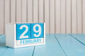 February 29th. Cube calendar for february 29 on wooden surface with empty space For text. Leap year, intercalary day Royalty Free Stock Photo