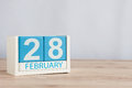 February 28th. Cube calendar for february 28 on wooden surface with empty space For text. Not Leap year or intercalary Royalty Free Stock Photo