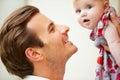 Feche acima do pai holding baby daughter Imagens de Stock Royalty Free