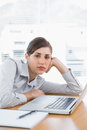 Fed up businesswoman looking at camera her desk Royalty Free Stock Photography