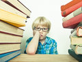 Fed up kid bored child at the library Royalty Free Stock Images