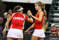 Fedcup tennis game ukraine vs canada kyiv april eugenie bouchard r and sharon fichman of cheer up each other during bnp paribas Stock Photos