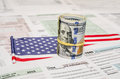 Federal Income 1040 tax return form with money and flag Royalty Free Stock Photo