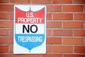 Federal no trespassing sign on a brick wall Royalty Free Stock Images