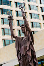 Federal reserve bank statues in kansas city landmark located outside the of modern architecture building urban environment Royalty Free Stock Photography