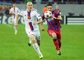 Federico piovaccari and ivan ivanov during champions league game steaua s fc basel s pictured in action the uefa between steaua Royalty Free Stock Images