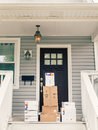 FedEx boxes on front porch Royalty Free Stock Photo