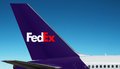 Fedex logo on plane federal express is the tail of close up the beautiful blue sky background the sky area is free for your Stock Image