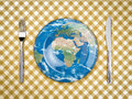 Feed the world knife fork and plate with map on it Stock Photo