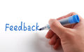 Feedback concept hand writing with blue marker on paper Stock Photos