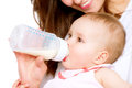 Feeding baby eating milk from the bottle Stock Image